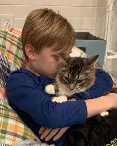Harrison cuddles Huck